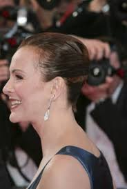 side view of pulled back hair in a bun carole bouquet charlotte rling hair styled back away from