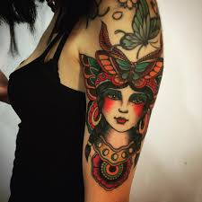 traditional tattoo on left half sleeve by inkflow claudio