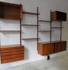 Bookshelves And Wall Units Floating Brown Wooden Shelves With Black Handler Plus Brown Wooden