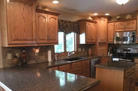 Kitchen With Oak Cabinets Kitchen Amusing Honey Oak Cabinets With Black Countertops Top Of