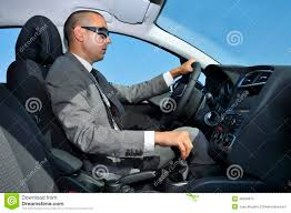 young man in suit driving a car stock photo image 46094673