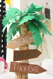 paper palm tree for luau decoration with pizza cardboard