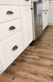 Grey Wood Floors Kitchen by Best 10 Kitchen Laminate Flooring Ideas On Pinterest Wood