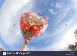 singing balloon happy valentines day helium balloon with blue sky heart shapes
