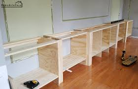 how to build a base for cabinets to sit on family room built in the countertop and base cabinet trim