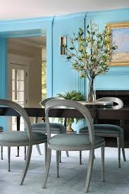 oval black dining table with gray open back dining chairs