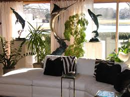 feng shui home design homesfeed tropical theme inside living room with white coach and black striped pillows