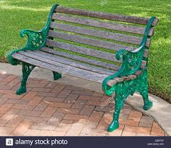 Refinishing Metal Patio Furniture - park bench wood and green painted metal bench in a public park