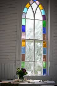 home design colorful palladian window with decorative plant on