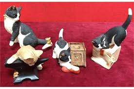 four sherrat and cat ornaments