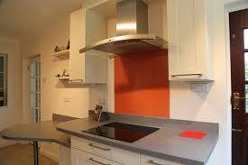 white kitchen orange splashback interior design