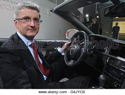 audi ceo audi ceo rupert stadler poses to a ducati motorbike at a