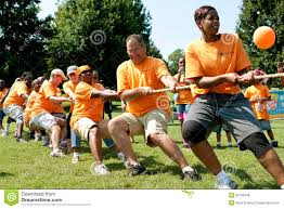 team pulls rope in tug of war competition editorial stock