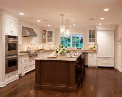 antique white kitchen cabinets with dark wood floors love the