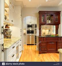 traditional kitchen with cream cabinets and built in dark wood