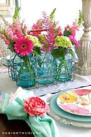 summer flowers in a colorful tablescape summer party decorations
