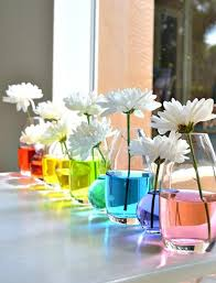 decorating pastel rustic table centerpieces with polaroid photos