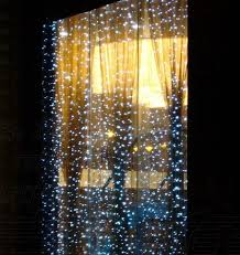 christmas lights in windows sparkling falling snow christmas lights window decor holiday