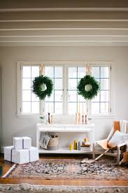 home decor idea using greenery in this christmas green wreath