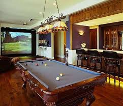 home billiard room design with wooden pool table and stained glass
