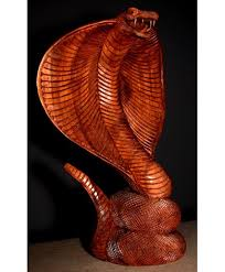 it s a one of a handmade carved wooden king cobra snake