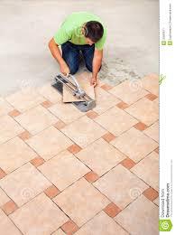 flooring howo install floorile man installing stock image