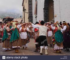 in regional costumes at romería de san isidro stock