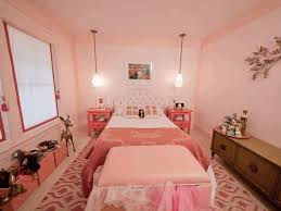 exquisite pink chandelier soft pink wall paint smooth brown carpet
