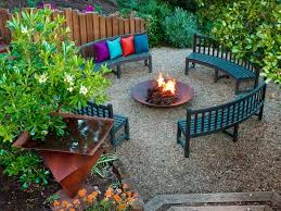 outdoor modern backyard fire pit with wooden chairs on the