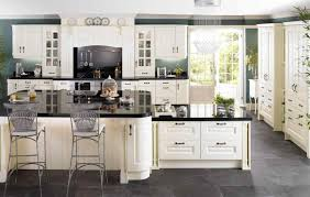 Granite Countertops For White Kitchen Cabinets by White Kitchen Cabinets With Granite Countertops And Dark Floors