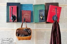 repurposed books into unique coat rack back to old