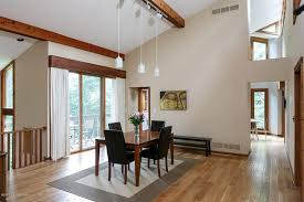 craftsman dining room with cathedral ceiling flush light in