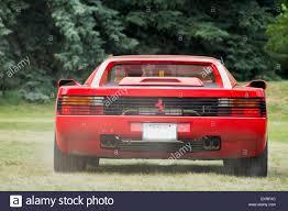 testarossa exhaust testarossa seen from the rear with exhaust fumes stock