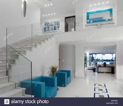 Modern White Arm Chairs Blue Armchairs And White Tiled Flooring In Large Modern White Hall