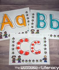 printable alphabet mat superhero alphabet play dough mats for letter learning
