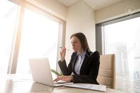 bureau d ontable serious self made businesswoman working at office desk on