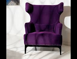 purple velvet upholstered wingback chair with nails accent