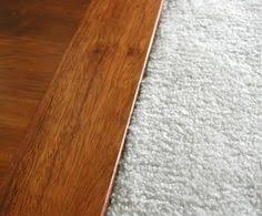 wood tile transition to carpet clubhouse of walk in