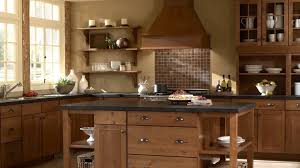 traditional wooden kitchen design with plate storage cupboards and