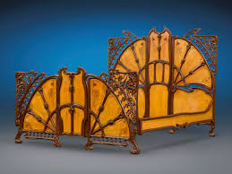 magnificent art nouveau cast iron bed interspersed with wood