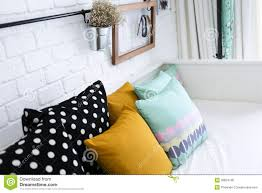 colorful pillows for sofa colorful pillows on a sofa with white brick wall i royalty free
