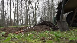 digging soil in the garden preparing it for vegetable plants