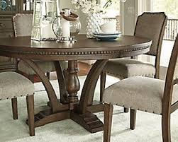 ashley dining room tables larrenton dining ashley homstore s very own new traditional