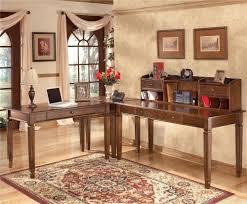 signature design by ashley hamlyn 4 piece l shaped desk rotmans