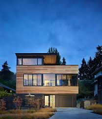 bi level house exterior contemporary with floor to ceiling windows