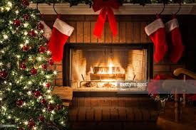 Christmas Tree Decorated With Stockings by Decorated Christmas Tree Blazing Fire In Fireplace Stockings