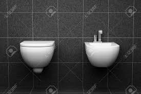 Modern Toilet by Modern Toilet With Black Tiles On Wall Stock Photo Picture And
