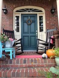 resultado de imagen para best front door color for orange brick