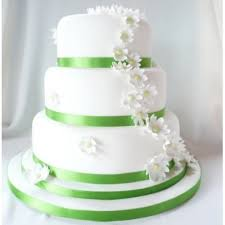 wedding cake green green and white wedding cake with three tiers and flowers