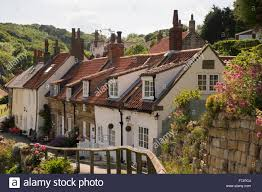 North Yorkshire Cottages by Row Of Traditional Quaint Cottages With Pantiles In The